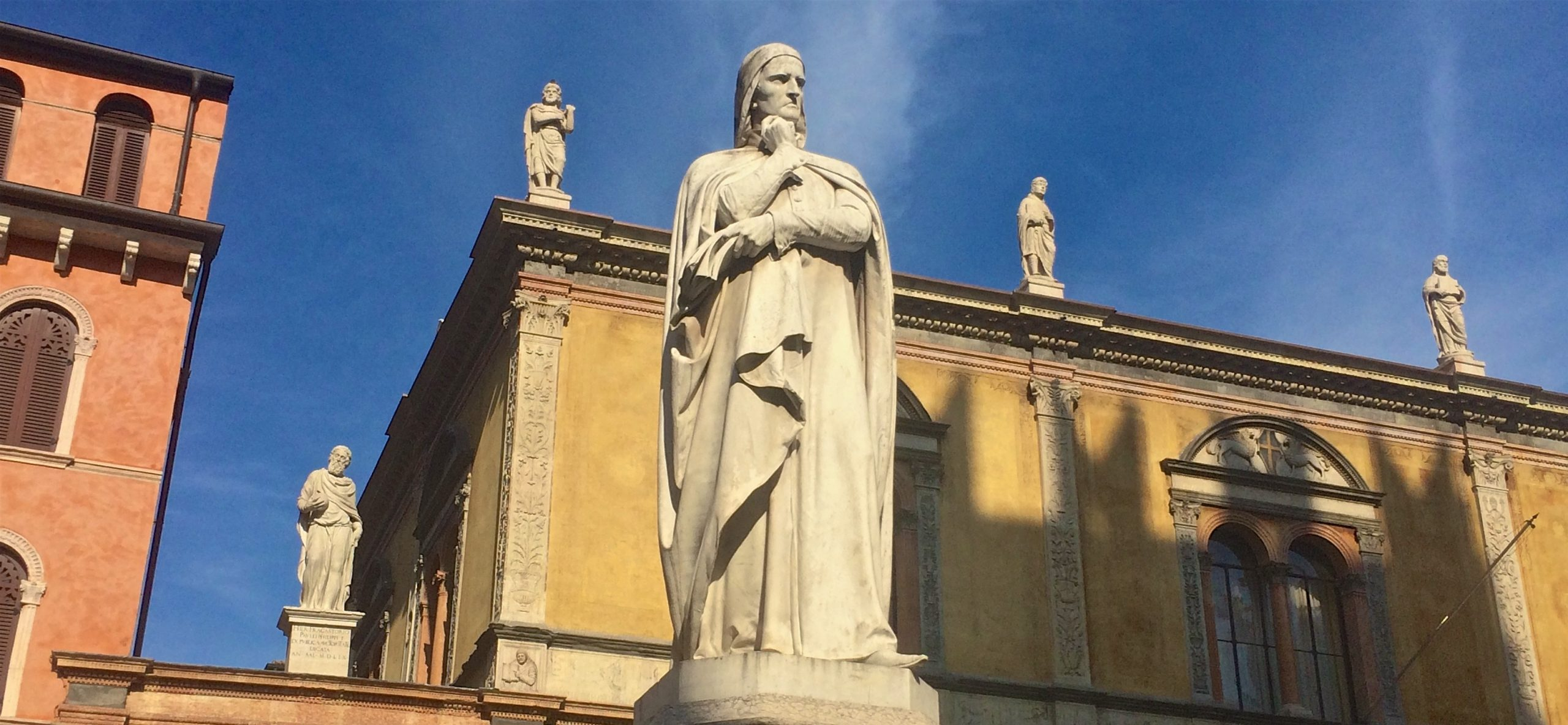 Why, if you go to Verona, will you find Dante looking at you so badly?